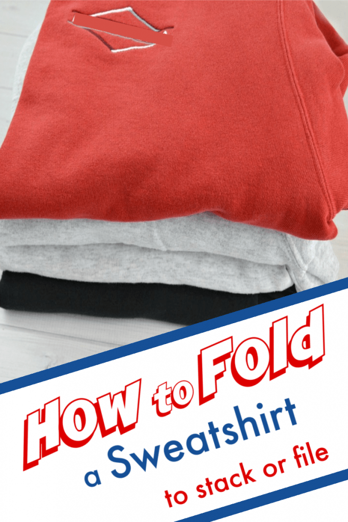 pile of neatly folded sweatshirts with red one on top