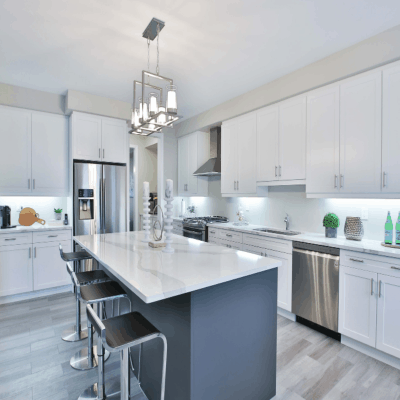 modern neat gray and white kitchen with stainless steel appliances