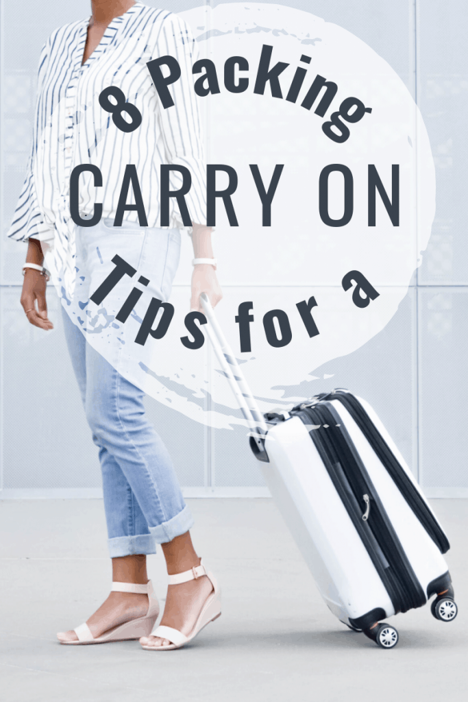woman in jeans pulling white carry on with title text overlay reading 8 Packing Tips for a Carry On
