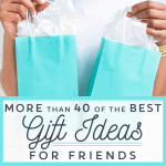 Woman holding 2 blue gift bags
