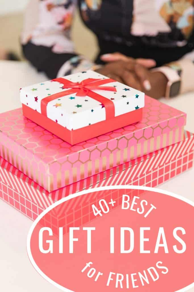 stack for presents in red paper with group of people in background with title text overlay reading 40+ Best Gift Ideas for Friends