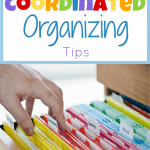 hand touching file folders organized by color
