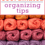 skeins of yarn organized in rows by color