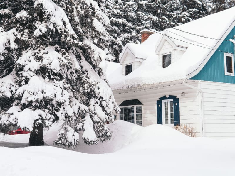 blue and white house covered with snow