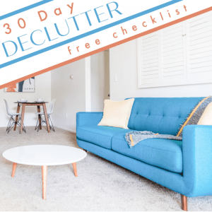 neatly organized living room blue couch & white round table