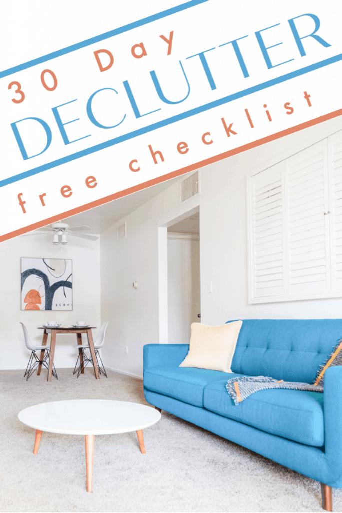 neatly organized living room with blue couch and round table with title text overlay reading 30 Day Declutter free checklist