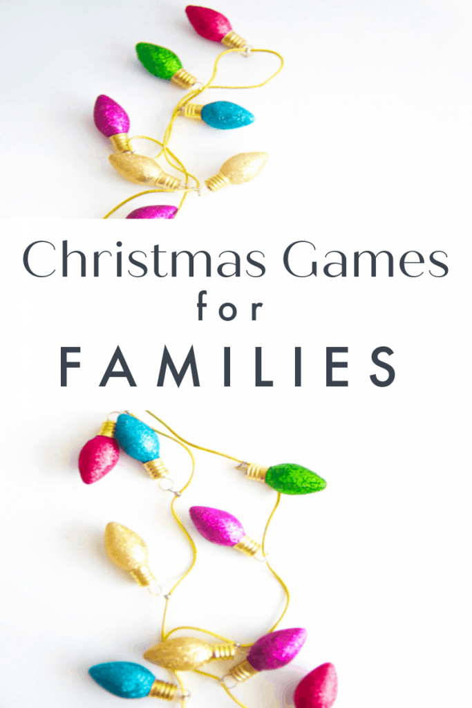 strand of brightly colored ornaments on white table with title text reading Christmas Games for Families