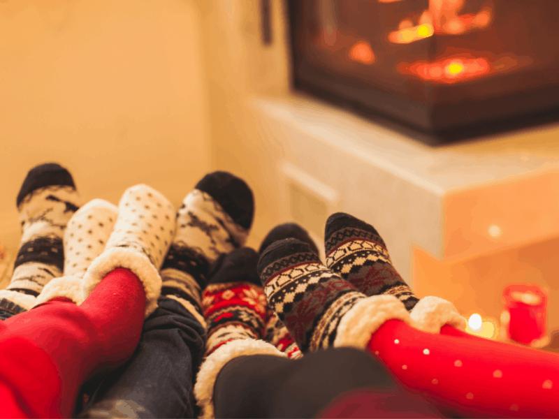 socked feet in front of fire