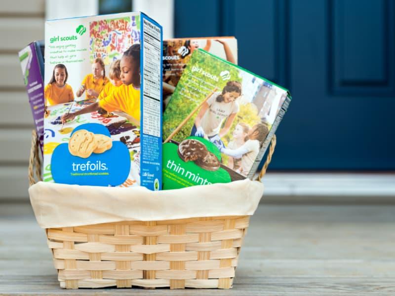 basket of Girl Scout cookies by front door