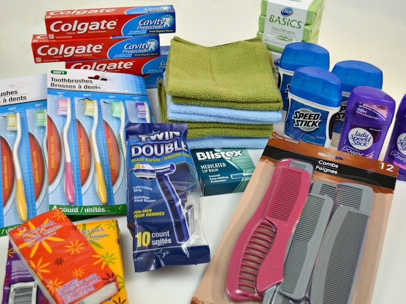piles of wash cloths, deodorant, combs, toothbrushes, toothpaste and soap
