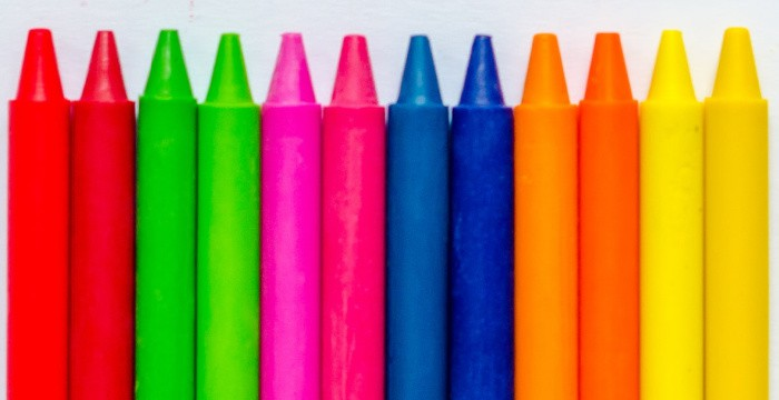 row of new brightly colored crayons