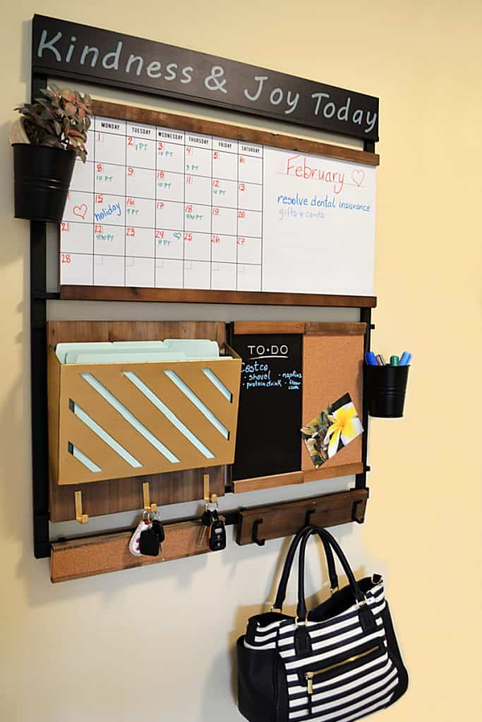 wall organizer with calendar, file holder, note areas and hooks
