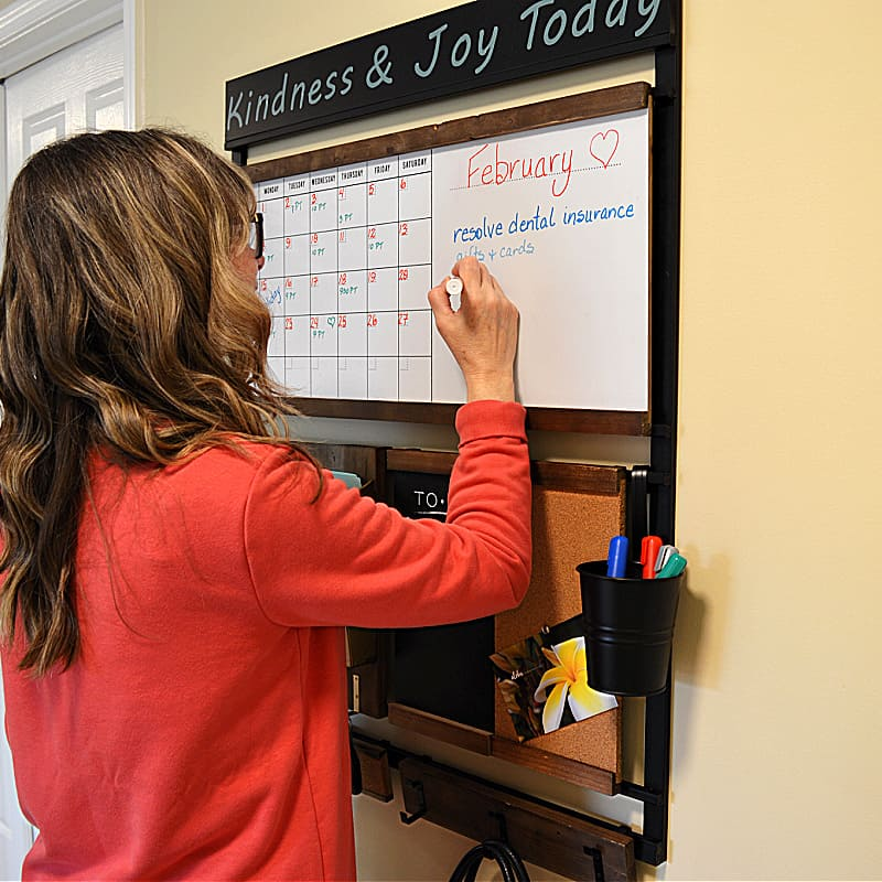woman writing on white board portion of family command center