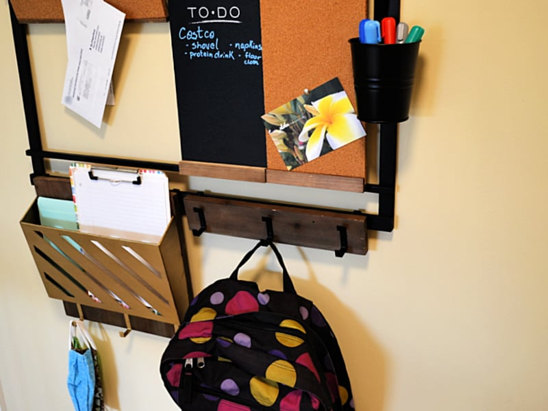 backpack hanging on hooks of wall family command center