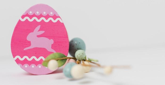 Large pink Easter Egg decoration on tabletop