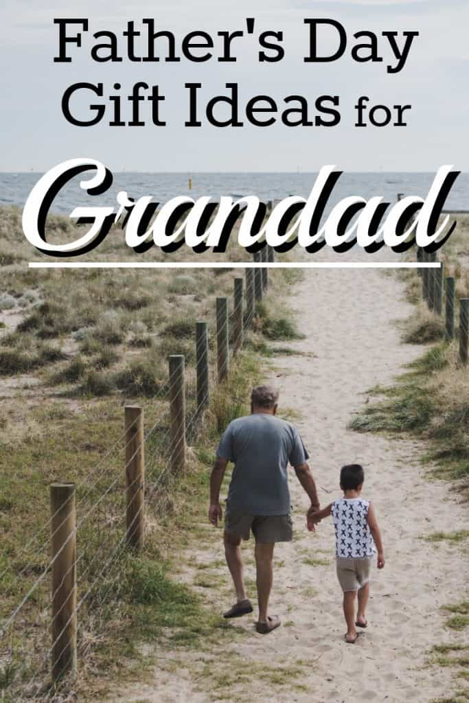 grandfather and child holding hands and walking to the beach