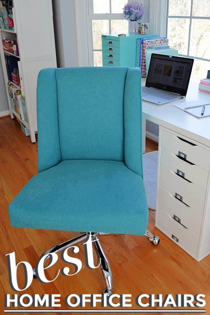 close up of blue fabric desk chair by white desk