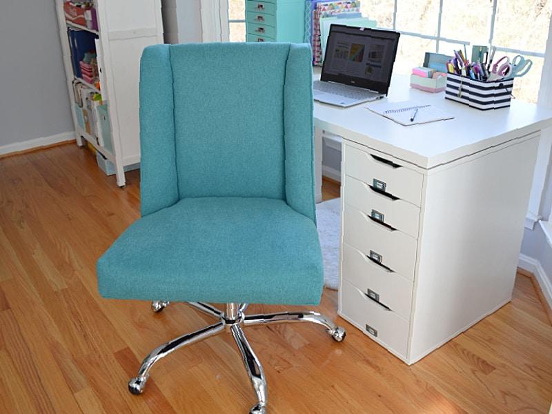blue modern desk chair next to desk