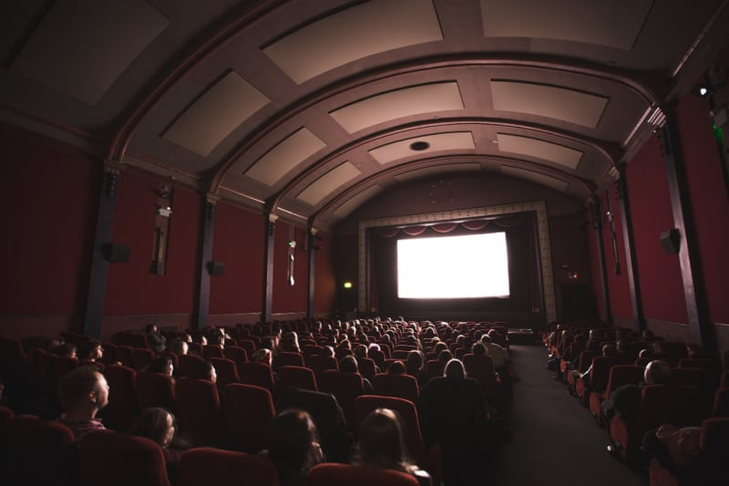 darkened movie theater with arched ceiling