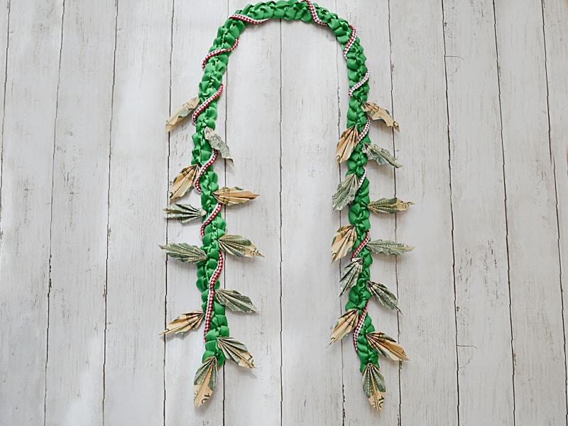 origami money lei made from ribbon and folded money