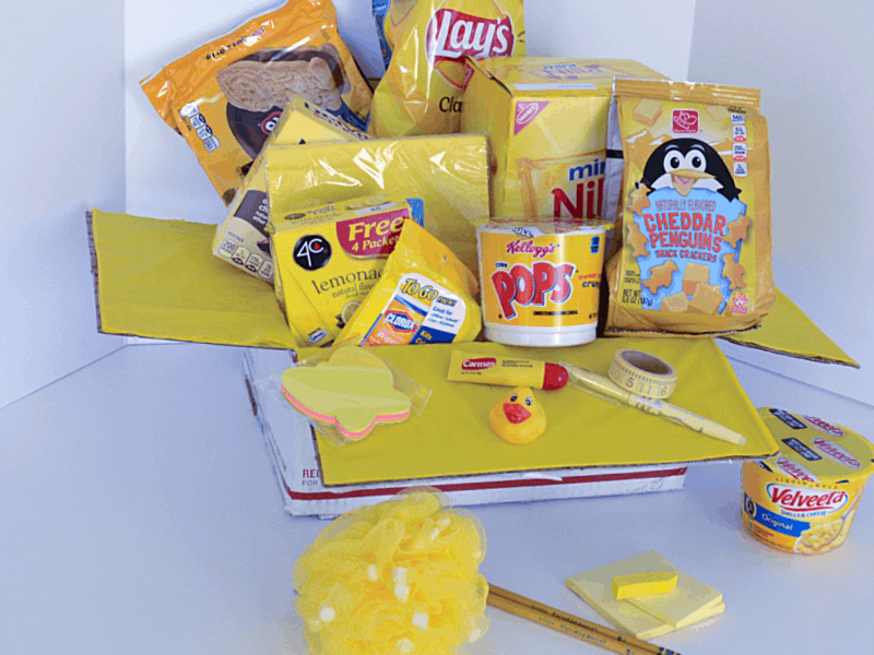 mailing box of yellow gift items