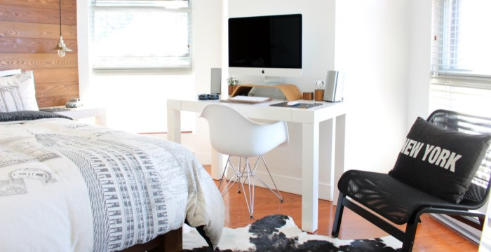 modern dorm room or apartment room with bed, desk and chair