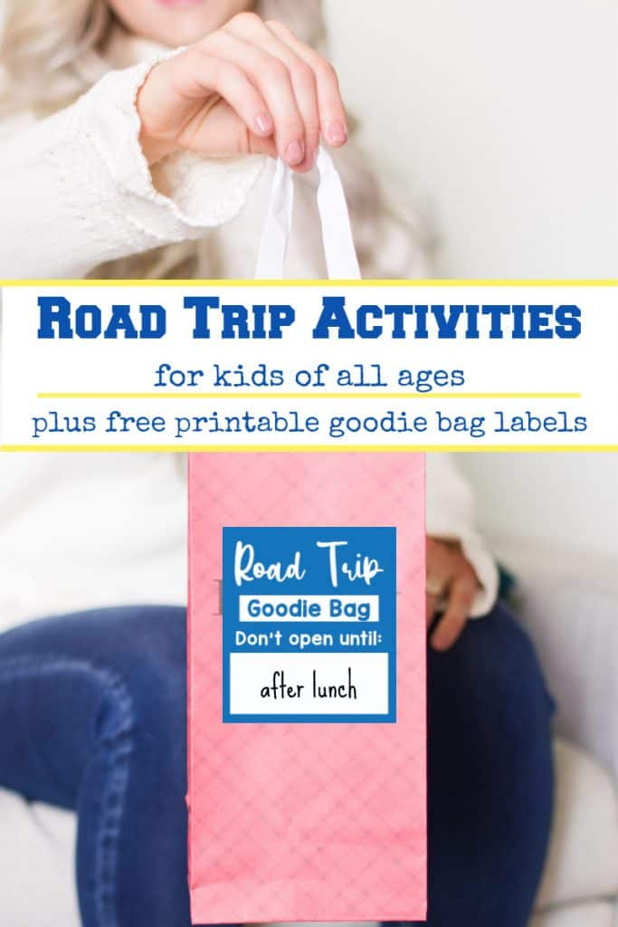 woman holding pink gift bag with blue road trip label