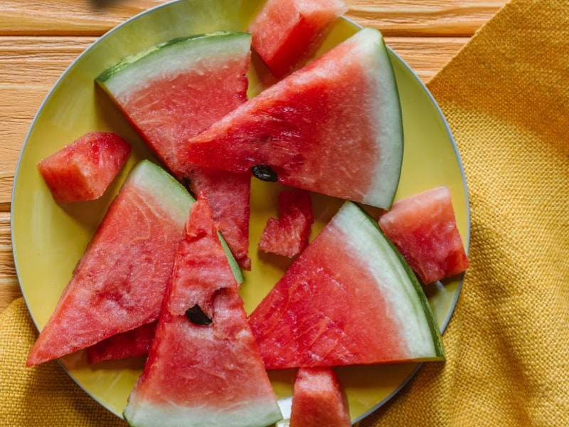 yellow plate of sliced watermelon