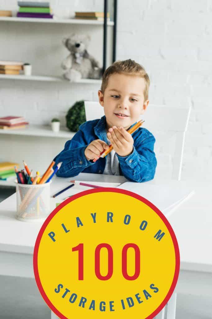 boy holding pencils in toyroom