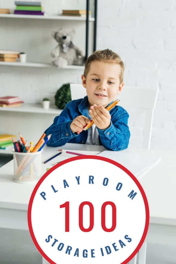 boy in blue shirt holding pencils at table in playroom with title text overlay reading 100 Playroom Storage Ideas