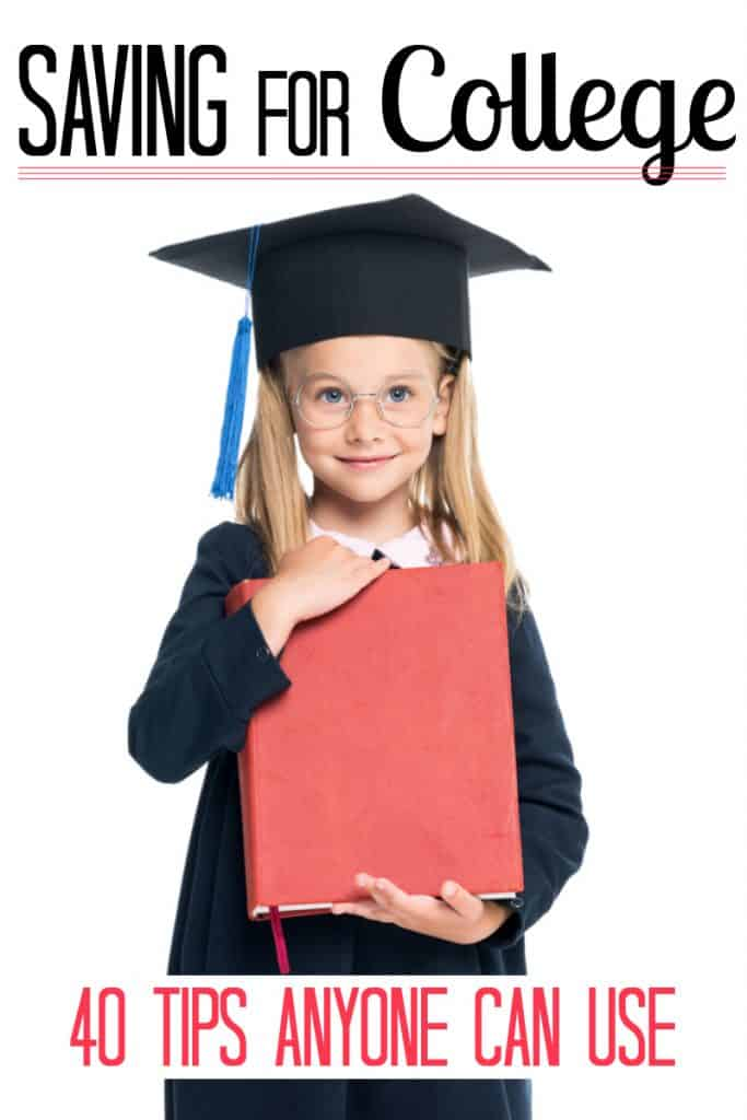 young girl in black graduation cap and gown holding big red book