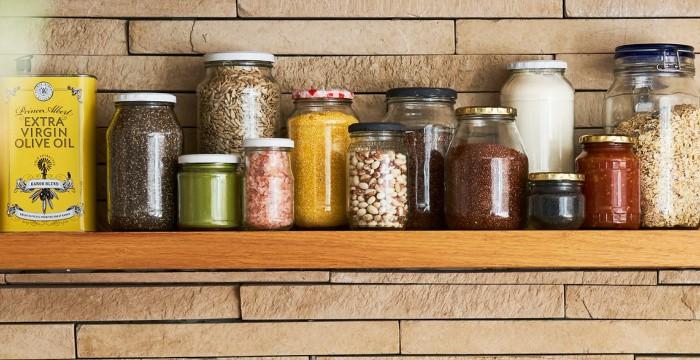glass jars of food neatly organized on shelf