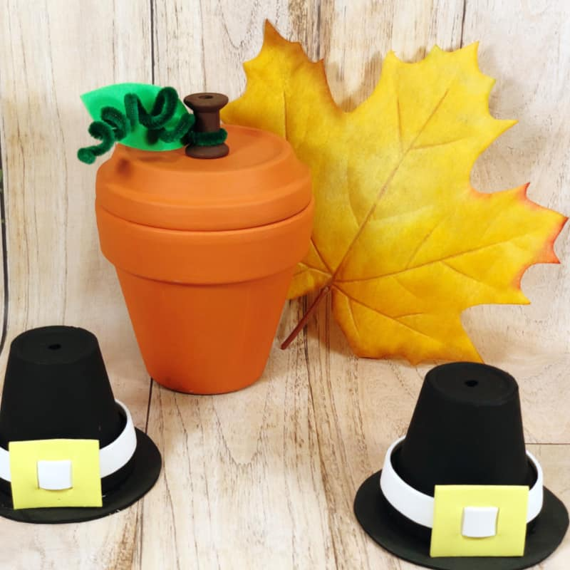 crafted clay pot pumpkin with 2 crafted clay pot pilgrim hats in front