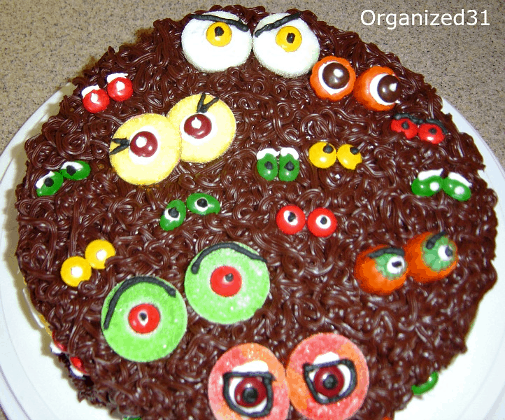 cake with chocolate frosting and candy decorated to look like eyes